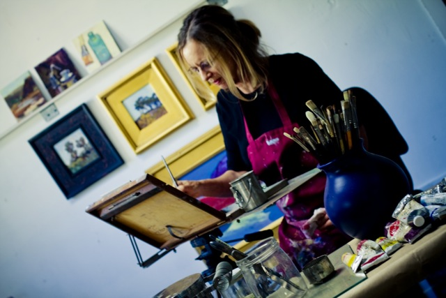 photo of Jori Owens in her studio painting